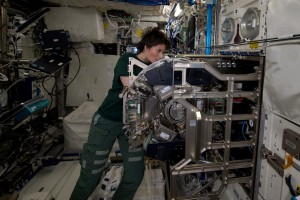 Samantha using centrifuge in preparation for the  Triplelux experiment.